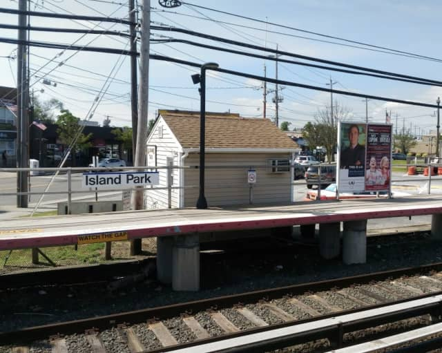 A man was arrested at the Island Park train station for allegedly having a loaded gun and marijuana.