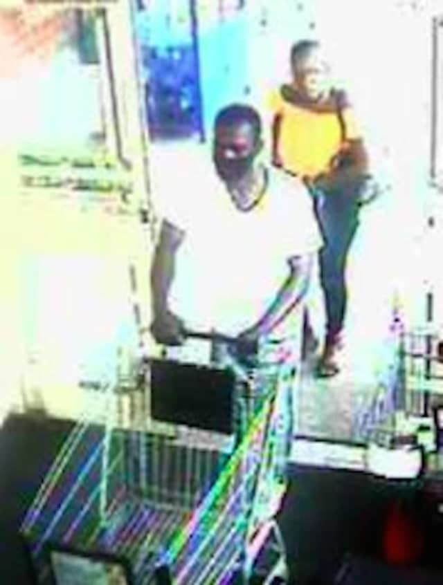 A surveillance still of the wanted pair.