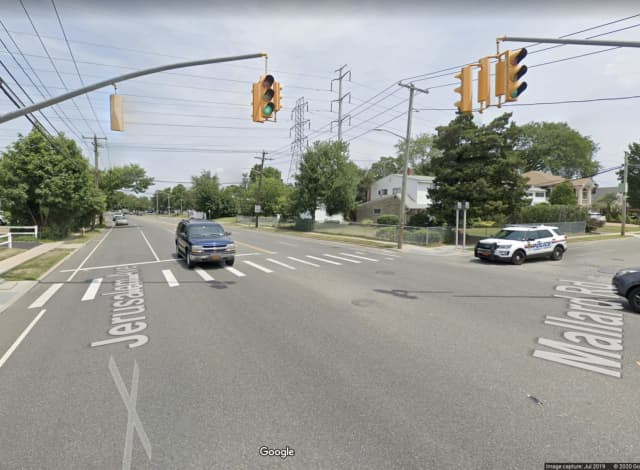 A man is in serious condition after being hit by a U.S. Postal vehicle in Levittown.