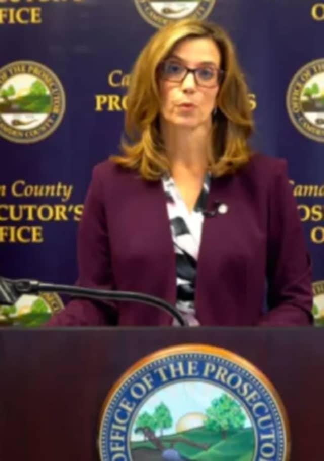 Acting Camden County Prosecutor Jill S. Mayer, center