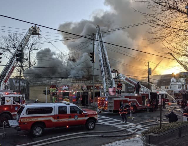 Yonkers firefighters are battling a four-alarm fire on Yonkers Avenue.