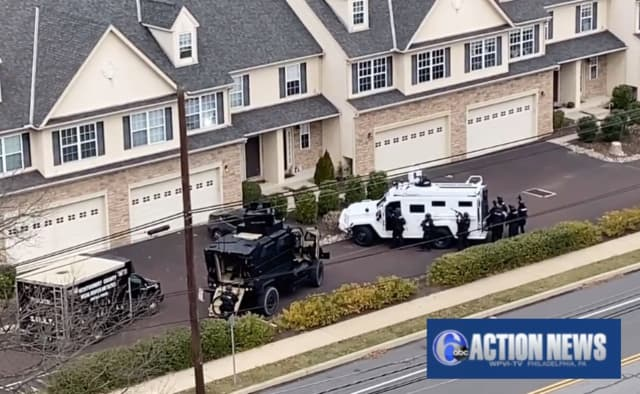 Footage from 6abc Action News shows armored vehicles at a home on Johnson Road and Germantown Pike around 10:45 a.m.