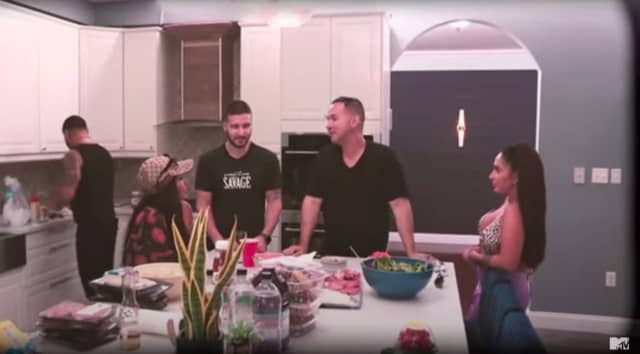 """""""Jersey Shore"""" cast members gather around the kitchen island in the Manalapan home where """"Jersey Shore Family Vacation"""" was filmed."""