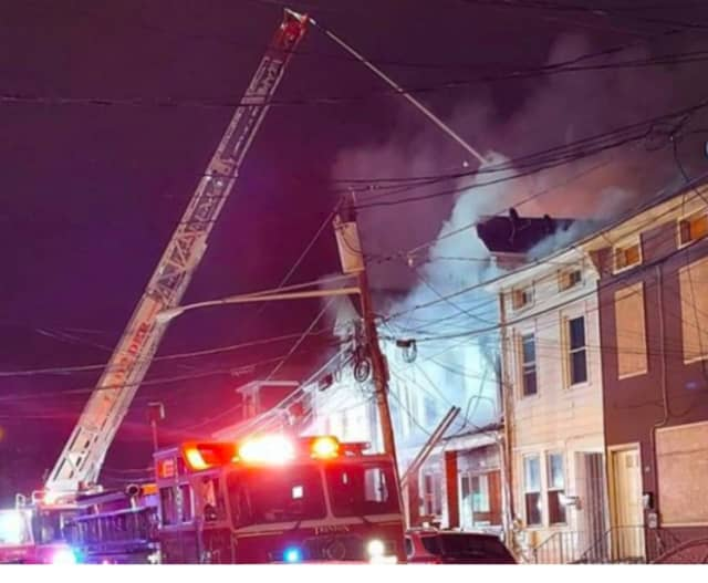 Firefighters at the scene of a fatal fire on Elm Street. (Courtesy Peterson's Breaking News of Trenton)