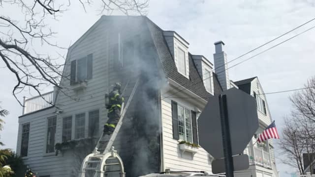 Firefighters battle the blaze at the home on East Beach Road in Norwalk.