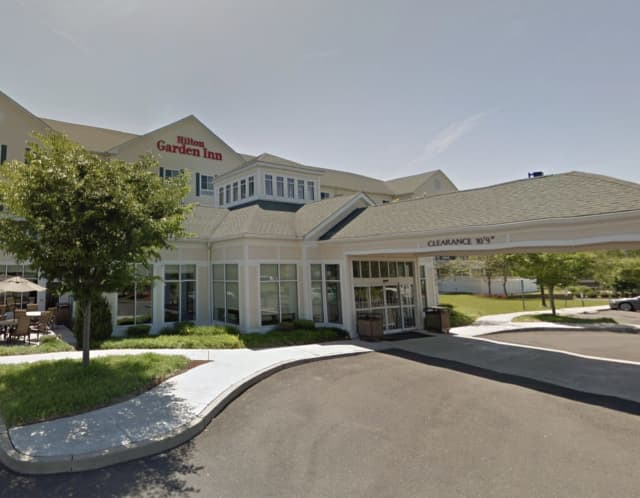 A man was arrested at the Hilton Garden Inn in Milford for allegedly attacking a pregnant woman.