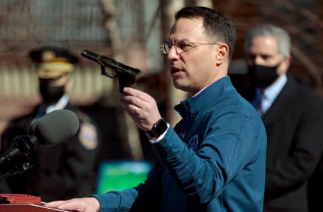 PA Attorney General Josh Shapiro holds up a ghost gun seized in March out of Berks County.