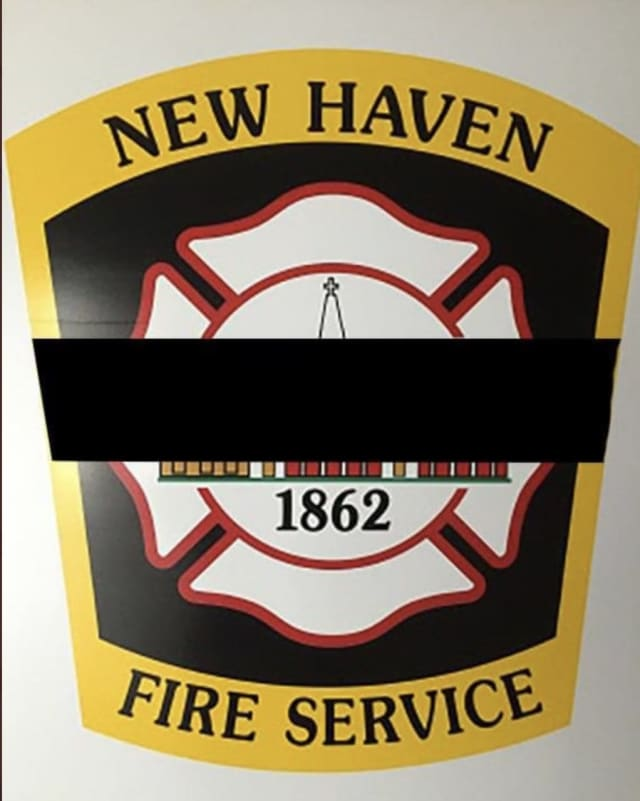 A New Haven firefighter was killed and three others injured, one critically, battling a house fire.