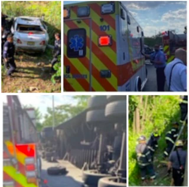 Newark firefighters rescue a driver whose car fell down an embankment Tuesday.
