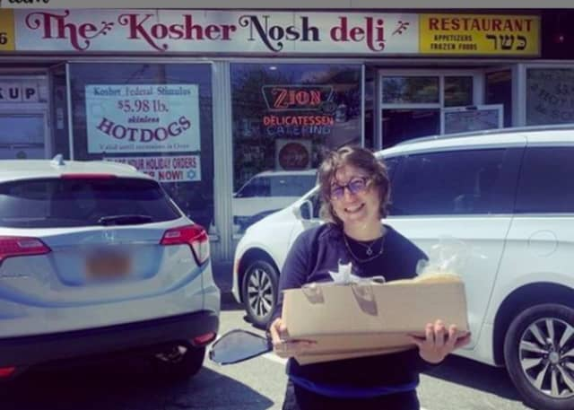 Mayim Bialik drops by The Kosher Nosh Deli in Glen Rock.