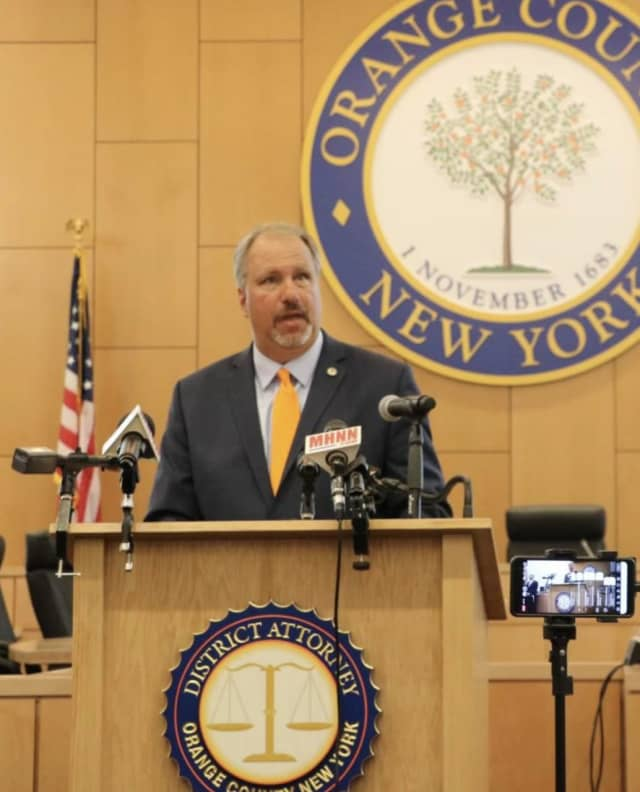 Orange County District Attorney Dave Hoovler makes the guilty plea announcements during a press conference.