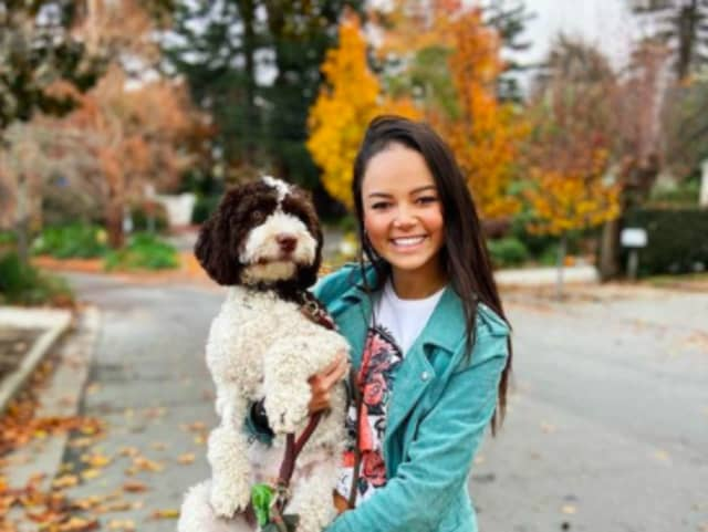 """Nia Morgan and her dog, who she is referring to as """"Z"""" for his safety. She purchased the dog in 2020 when he was two months old."""