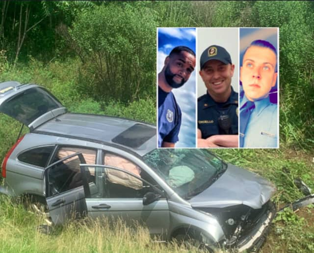 Wood-Ridge firefighter Dan O'Beirne, Rutherford volunteer EMT Walter Rogers, Wood-Ridge Police Officer Mark Torsiello and NJ corrections officer Chris Aurajo (not pictured) rescued three women trapped in a vehicles on the NJ Turnpike.