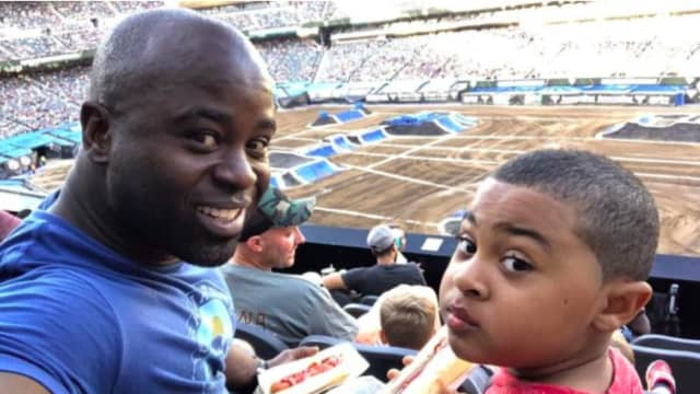 Jersey City police officer Morton Otundo and his son, Andrew.