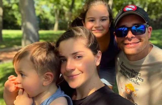 Isabel Cucalon and Nelson Roman with their kids.