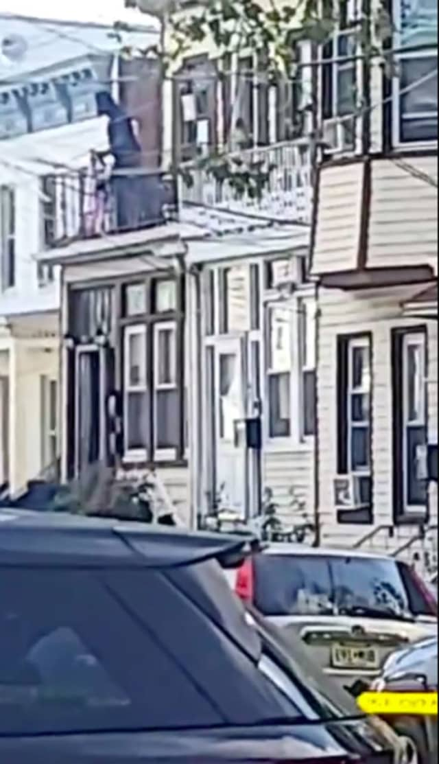 """""""Don't do it brother,"""" says a man capturing the disturbing incident Saturday morning at the Jersey City home."""