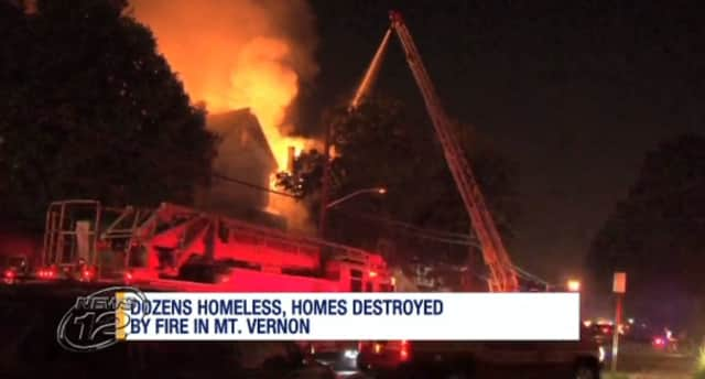 A fire tore through two homes and damaged a third in Mount Vernon on Saturday night. Arson is suspected.