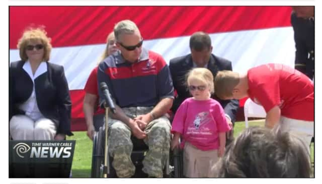 Stephen Valyou, an Army veteran wounded in Iraq in 2007, was presented with a smart home Thursday provided by the Stephen Siller Tunnel to Towers Foundation.