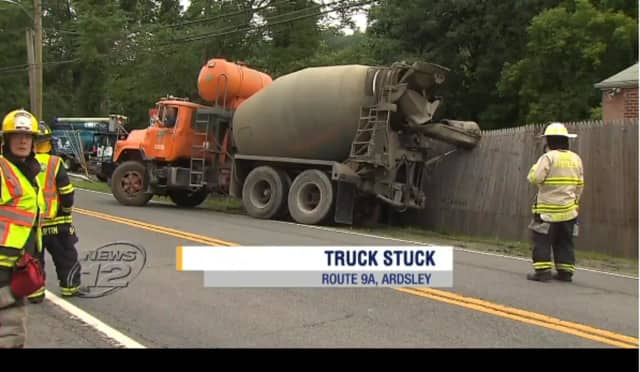 A truck needed to be towed out of deep mud Monday along the side of Route 9A in Ardsley.