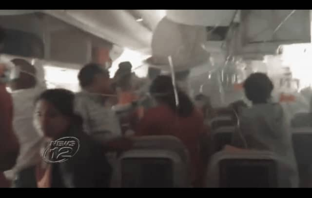 Riya George's cellphone footage captured her experience on board an Emirates Air flight that crashed Wednesday in Dubai.