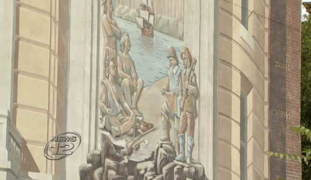 This mural at 36 Main St. is set to be demolished despite the opinions of a group of activists who'd like to see it saved.