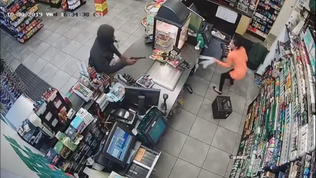 A man is seen pointing a gun at a clerk during the robbery of a Bloomfield gas station last week