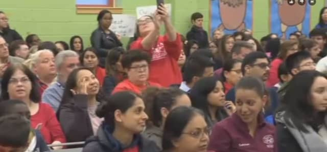 Several dozen people attended the Jersey City school board meeting Monday night to protest proposed staff cuts.