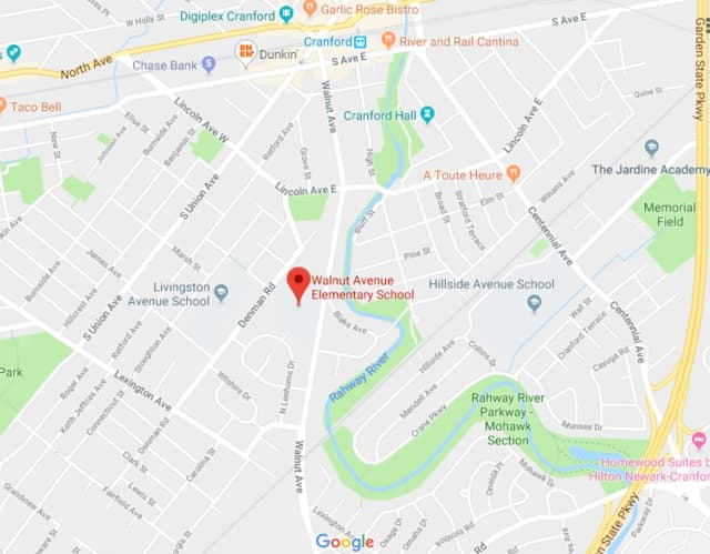 A crossing guard was assisting a student in Cranford when she was hit by a car, police said.