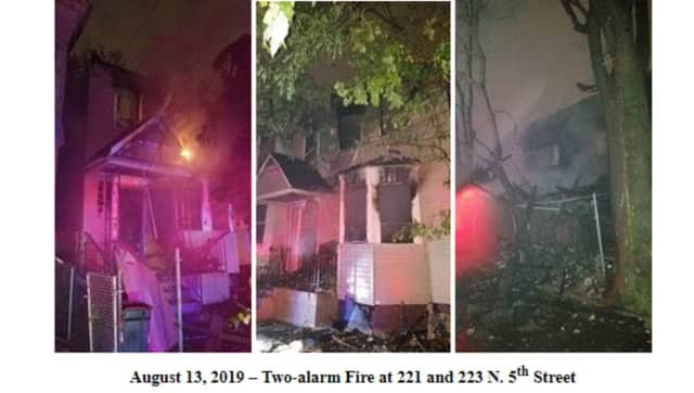 Two houses, including an occupied home, were damaged in Newark Tuesday night.
