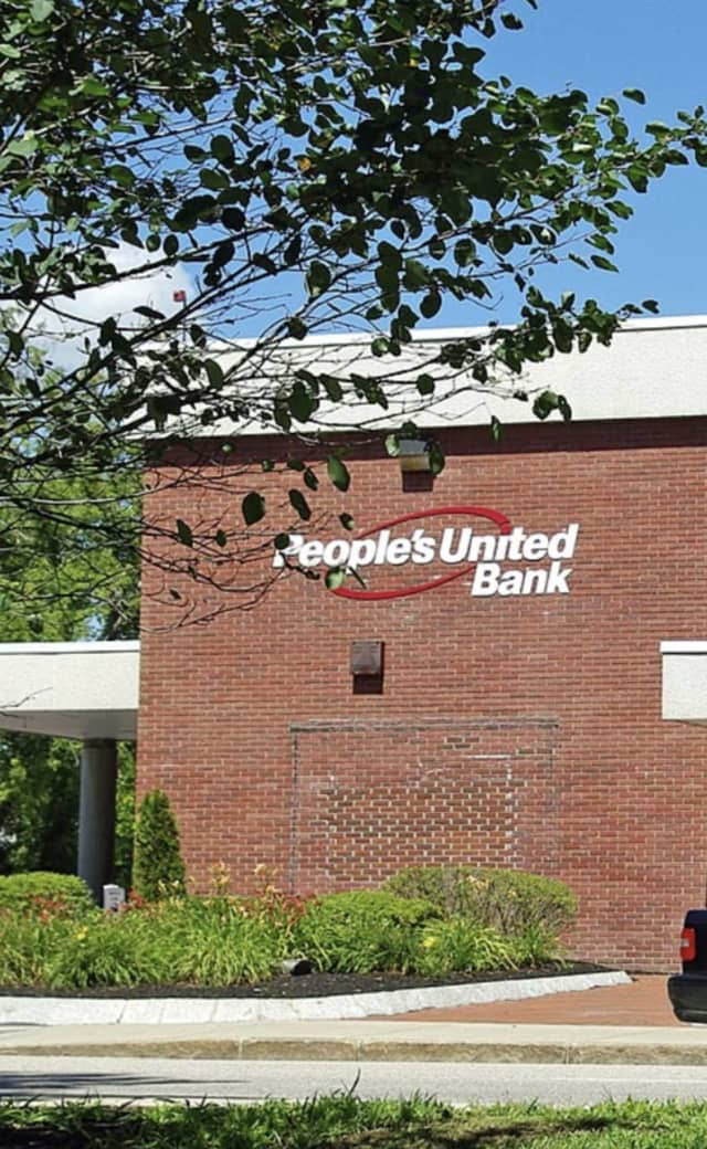 Connecticut-based People's United Bank is being accused of discrimination by a former employee. Pictured here is one of the bank's branch offices in New Hampshire.