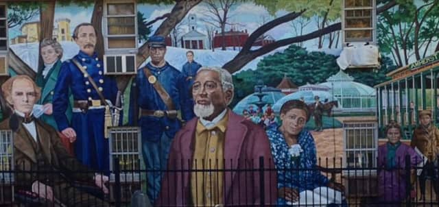 A Western Massachusetts town known for its out-of-the-box programs and solutions to local and national issues is eyeing the creation of an art tax. Pictured here is a mural in Amherst.