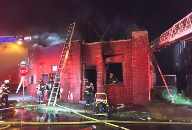 Police have arrested a man accused of setting a vacant Springfield building on fire.
