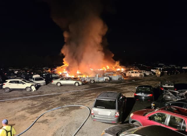Firefighters responded to a report of a parking lot full of cars on fire Saturday, Sept. 5.