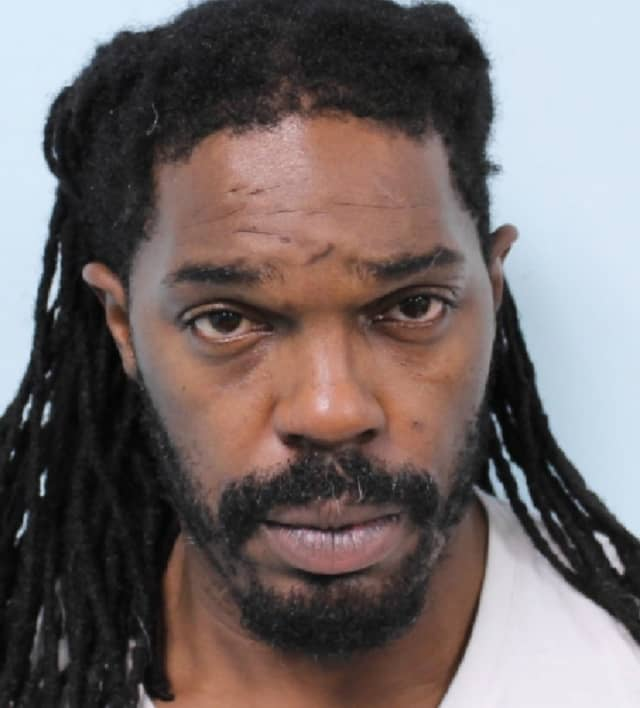 Titus Crews of Springfield (pictured here) is accused of strangling a woman in an effort to steal her purse.