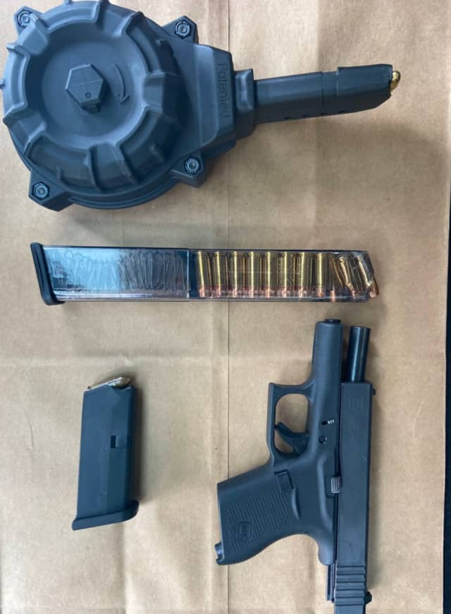 The gun and ammunition pictured here were seized following a lockdown at two Hartford schools. The lockdown was a precaution after a shooter in the area was reported, Sept. 24. Two men are in custody.