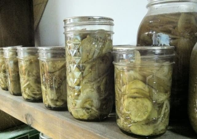 Mason jars full of pickles.