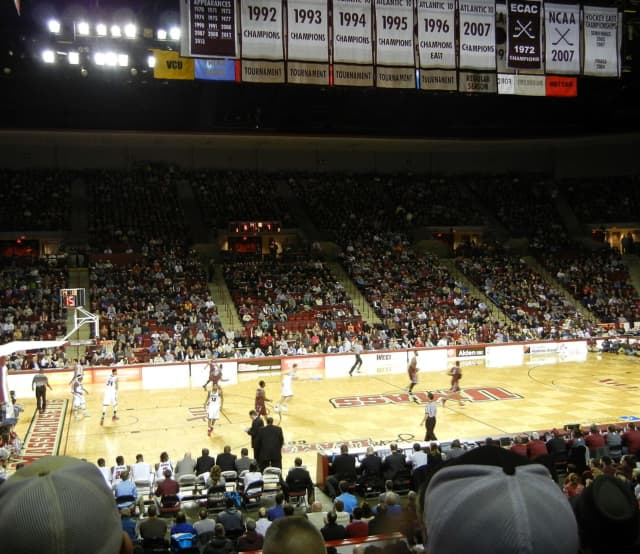 UMass Men's Basketball play at the Mullins Center in 2014.  The photo is being used as an illustration. The game pictured  was not part of the 2020 NCAA review.