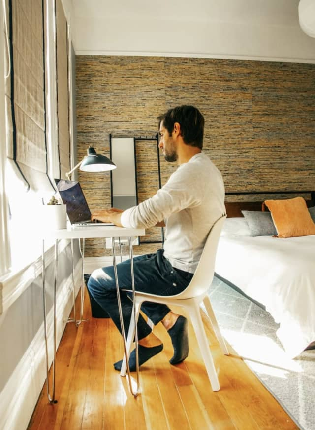 A man works from a co-living and working space run by Outsite.