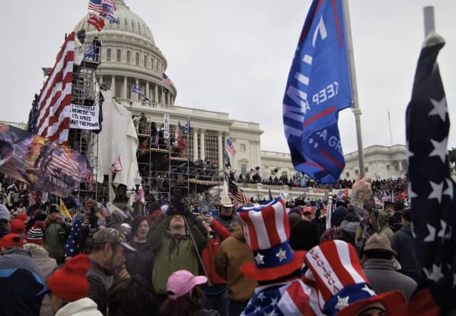 A group of anti-democracy, pro-Trump terrorists assault the Capitol Building in Washington, D.C. on Jan. 6.