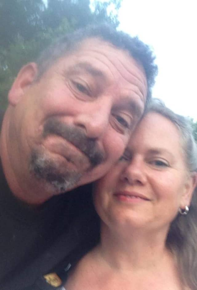 Kevin Bertuco, 56, and Renee Bertuco, 55, of Reading, on their anniversary in 2019.