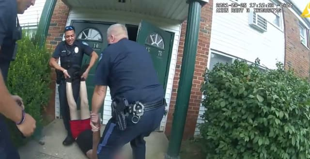 Bensalem police officers rescuing a man from an apartment fire on Aug. 25.