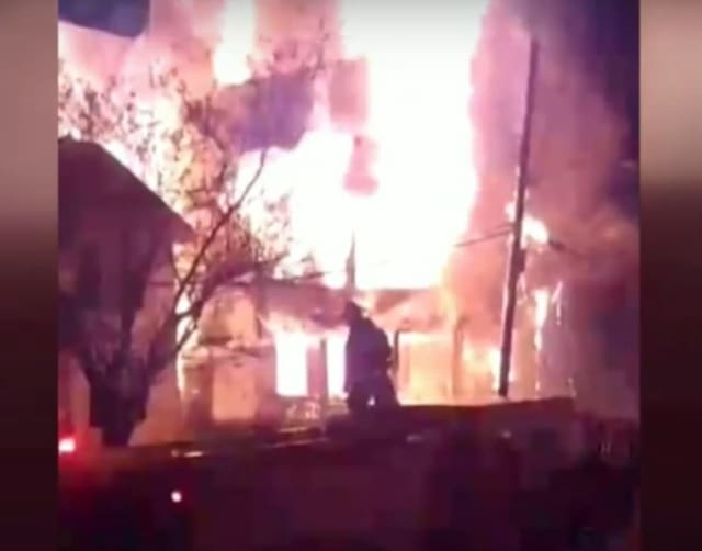 A fire that tore through several homes in Irvington early Wednesday is under investigation.