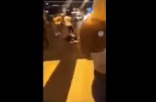 A Newark man is seen in a viral video getting kicked and punched in Jersey City early Sunday morning.