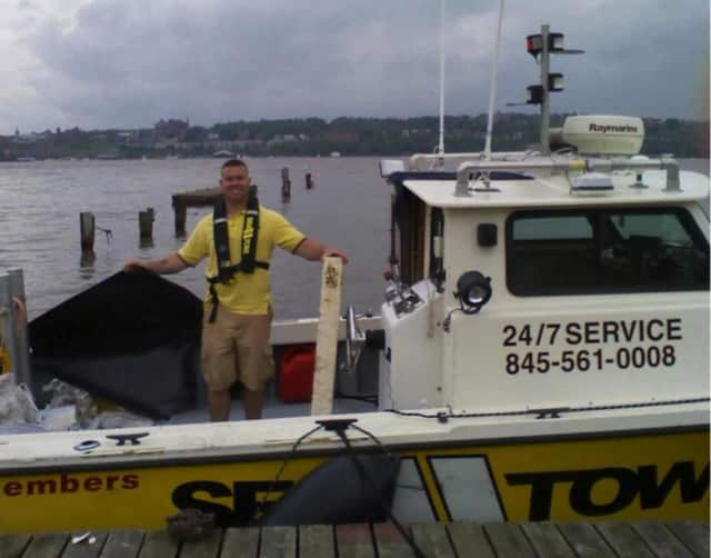 A ship from Sea-Tow Central Hudson helped remove a seven-foot tractor tire from the Hudson River.