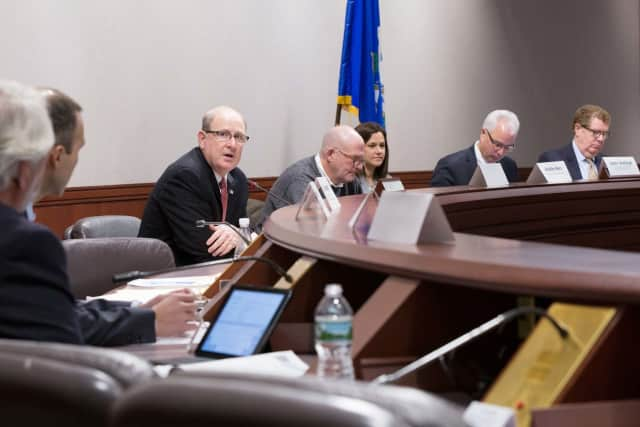 Sen. Kevin Kelly (R-Monroe, Shelton and Stratford) leads a hearing on insurance costs at the Capitol in Hartford on Monday.