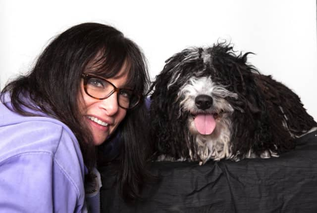 Sheryl Gaines of Tenafly with her Grand Champion Casa de Rancho's Mona, shown Monday in the first group of her breed to compete in the Westminster Kennel Club dog show.