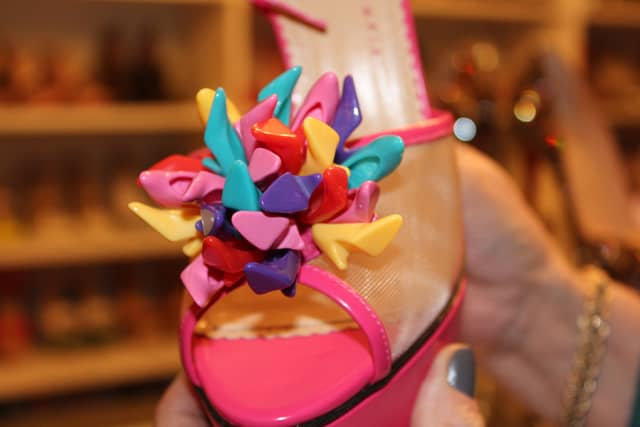 Another pair of Charlotte Olympia shoes, which features a multicolored pom-poms made of doll shoes, inspired by Barbie. Photograph by Danielle Renda.