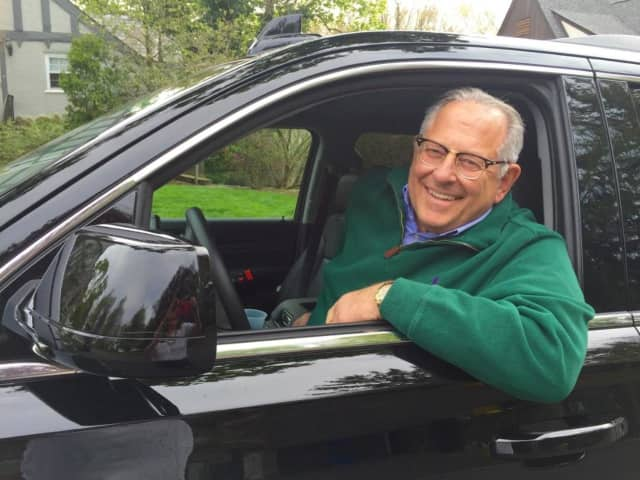 Robert Miller in his seven-seat 2016 Chevrolet Suburban.