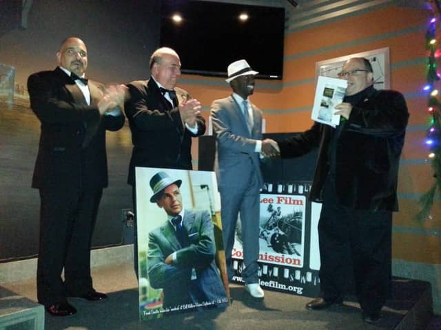 Marqiese Marc won the Sinatra Singoff sponsored by the Fort Lee Film Commission Saturday night. Also shown are Newark police officer Tommy Scala and George Chartofillis, 2014 champ. Tom Meyer, right, congratulates Marc.