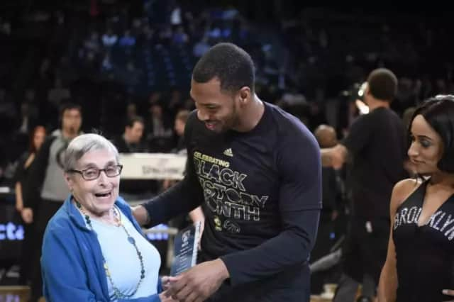 Sean Kilpatrick, seen here honoring his former English teacher, will have his jersey retired by White Plains High School.
